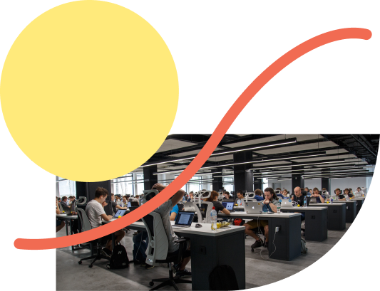yellow circle and orange squiggly line on cut-out office image
